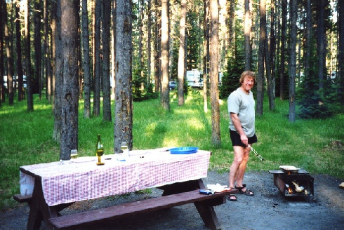 2002-06-12 18 Adrian having a barbie with new tablecloth at Whistlers campsite, Jasper, Alberta